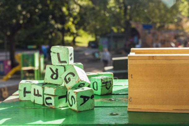 Green Wooden Blocks On Table Outside Kindergarten — Leisure Games