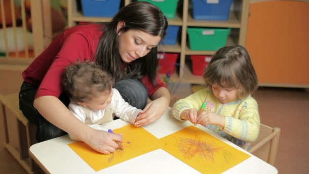 Preschool With Teacher Helping Toddler Stock Footage Video (100