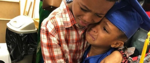 Sweet Moment Between Brother And Sister At Preschool Graduation