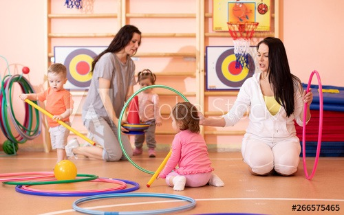 Kids Toddlers Play With Adults In Kindergarten Gym