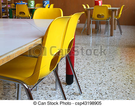 Kindergarten Classroom With Tables And Yellow Chairs Without Children